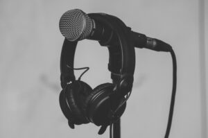 black-headset-hanging-on-black-and-gray-microphone-185030